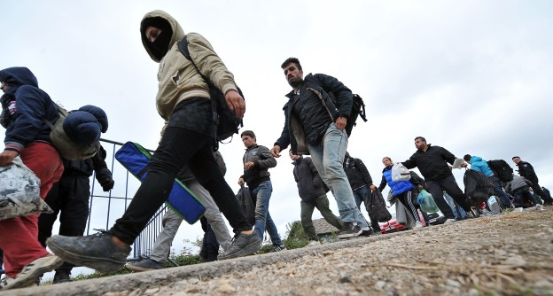 Migrants and refugees walk across the Serbian-Croatian border into the the village of Strosinci, near to the eastern Croatian town of Spacva, on September 26, 2015. Nearly 10,000 migrants entered Croatia September 25, a record daily influx since they started entering the country on their journey to seek a new life in western Europe, interior ministry said September 26. The overall number of the migrants who entered the European Union member from neighbouring Serbia during the past 10 days totalled 65,000, an interior ministry statement said. The influx started after Hungary sealed its border with Serbia earlier this month. AFP PHOTO / ELVIS BARUKCIC ####################ELVIS BARUKCIC